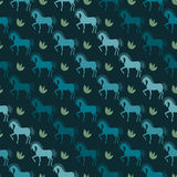 Blue horses seamless pattern background on the dark cover Stock Image