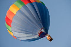 Blue hot air balloon shot sideways Royalty Free Stock Photography
