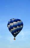 Blue hot air balloon in the sky Royalty Free Stock Photography