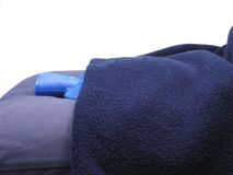 Blue hot-water bag wrapped in a blue blanket Royalty Free Stock Images