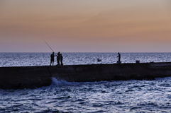 Blue hour angler with family assistance Stock Photos