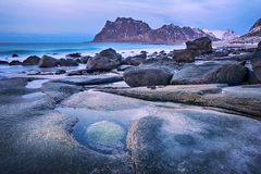 Blue hour. Beautiful Norway landscape of picturesque stones on the arctic beach of cold Norwegian Sea Stock Images