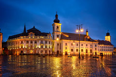 Blue Hour in Big Square. Sibiu city big square and it`s impressive city hall on a rainy evening at blue hour time royalty free stock photography