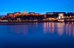 Blue Hour on the Blue Danube. Situated in Buda, on the western bank of the Danube, the Royal Palace and the Széchenyi Chain Bridge are two of the most stock photos