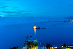 Blue hour of Bourtzi castle at Nafplio in Greece. Royalty Free Stock Photo