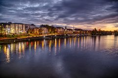 Blue hour in the city at the river stock image