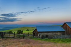 Blue Hour at Columbia Hills Natural Area Preserve and State Park. Blue Hour view of out buildings and vast landscape of The Dallas Mountain Ranch, a popular Royalty Free Stock Image