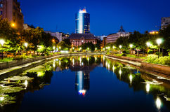 Blue hour on Dambovita River. Beautiful city lights and reflexions at the blue hour on Dambovita River, Bucharest Royalty Free Stock Image