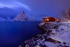 Blue Hour in Hamnoy ,Lofoten Archipelago, Norway in the winter time, water reflexion in Hamnoy. Blue Hour in Hamnoy Lofoten Archipelago , Norway in the winter Royalty Free Stock Images