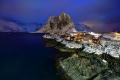 Blue Hour in Hamnoy ,Lofoten Archipelago, Norway in the winter time, water reflexion in Hamnoy. Blue Hour in Hamnoy Lofoten Archipelago , Norway in the winter Stock Photos
