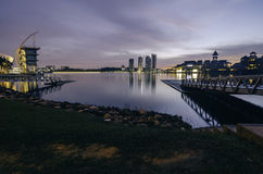 Blue hour at the lakeside with modern structure. wooden jetty, building and resort with tower Royalty Free Stock Image
