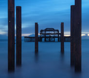 Blue hour landscape of destroyed old pier long exposure Royalty Free Stock Image
