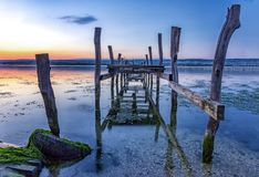 In blue hour. Old broken wooden pier in blue hour Royalty Free Stock Photo