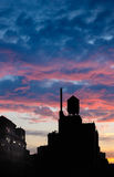 Blue hour outlining Chelsea water tower, Manhattan, NYC. Blue hour and its magical red and pink clouds enhance the silhouette of a water tower standing high on Stock Photos