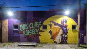 Blue hour photo Batgirl mural Bishop Arts District, Dallas, Texas. Pictured is a blue hour photo of the well known batgirl mural in the Bishop Arts District stock photo
