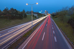 Blue hour photo on city highway with light trails Stock Images
