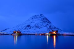 Blue Hour in Reine, Lofoten Archipelago, Norway in the winter time, water reflexion in Hamnoy. Blue Hour in Reine ,Lofoten Archipelago , Norway in the winter Royalty Free Stock Images