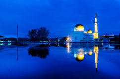 Blue hour sunrise at floating mosque with reflection. Royalty Free Stock Photos