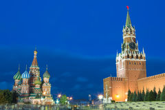 Blue hour sunset view of St. Basil Cathedral and Kremlin tower at Moscow Red Square. World famous Russian Moscow landmarks. Touris. M and travel concept Royalty Free Stock Photography