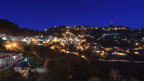 Blue hour view of Landour hill station, Uttarakhand. Blue hour view of Landour hill station facing the direction of Lal Tibba hill. Houses and streets are seen Royalty Free Stock Images