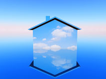 Blue  house. A house with a blue sky and clouds for decoration Royalty Free Stock Images