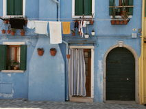 Blue house. A view of the outside or exterior of a blue house in Venice, Italy Stock Photos