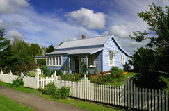 The Blue House. New Zealand dwelling with dramatic sky stock photography