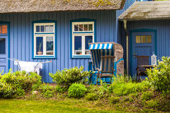 Blue house with beach chair Royalty Free Stock Photo