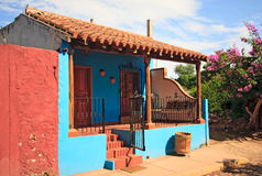Blue house with bright red wall. Bright blue house in El Quelite in Mexico stock photos
