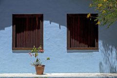 Blue house with brown window, typical colorful of Trancoso Stock Photography