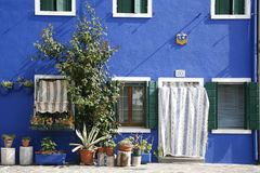 Blue house Burano. Colorful house on the island of Burano in the Venetian lagoon - Italy Stock Photo