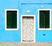 Blue house with closed windows as background Stock Photos