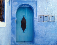 Blue house doors - Chefchaouen, Morocco. Blue house with blue traditional arabic doors in Moroccan city Chefchaouen (or Chaouen), very popular place for tourists royalty free stock image