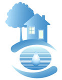 Blue house and a drop of water. Blue house on the clean planet and drop of water Stock Photography