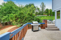 Blue House exterior. Walkout deck with barbeque and patio set. Northwest, USA royalty free stock photo