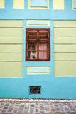 Blue house facade with wooden window from Sighisoara city old ce Royalty Free Stock Photos