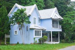 Blue house in forest Stock Photos