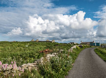 Blue House, Green Field and Single Track Road, Orkney Royalty Free Stock Image
