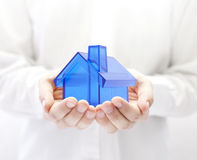 Blue house in hands Stock Photography