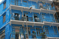 Blue House (Hong Kong). Blue House, refers to a 4-storey balcony-type tenement block located at 72-74A Stone Nullah Lane, Wan Chai. It is named for the brilliant Royalty Free Stock Image