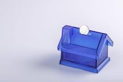 Blue House Money Box on White Background Stock Image
