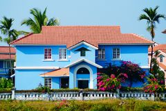Blue house near the beach in Benaulim, South Goa, India. Bright colors. Blue house near the beach in Benaulim, South Goa, India. Big mansion Royalty Free Stock Images