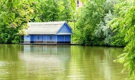 Blue house near the lake Royalty Free Stock Photo