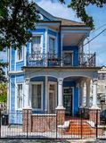 Bright Blue House in New Orleans, Louisiana 7th Ward. A blue house in New Orleans, Louisiana, USA 7th Ward Treme. Wood exterior with bright colors and a brick Stock Images