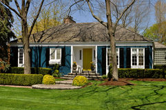 Blue house with nice landscaping Stock Photos