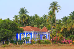 Blue House in Portuguese style with a slate roof in Goa, India. There are often shooting Bollywood films. Anjuna, Goa, India Royalty Free Stock Photo