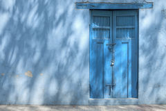 Blue house in shadows Royalty Free Stock Photo