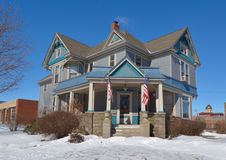 Blue House In Snow Stock Photo