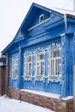 Blue house in Winter stock photos