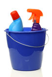 Blue household bucket with cleaning bottles Stock Image